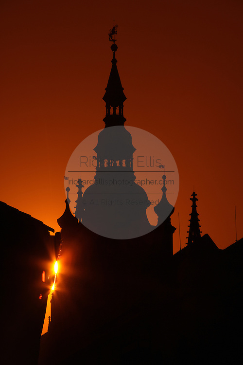 Prague Castle silhouetted against the setting sun in Prague, Czech Republic. The castle, first constructed in the 10th century is the seat of government in the Czech Republic.