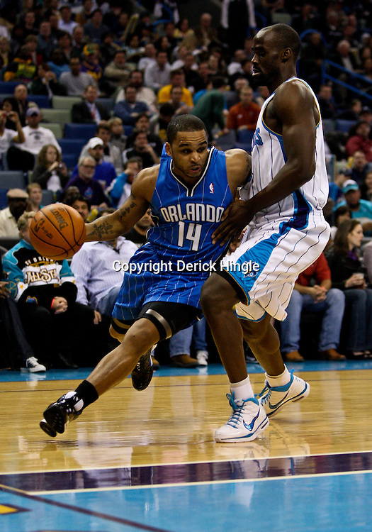 Feb 26, 2010; New Orleans, LA, USA; Orlando Magic guard Jameer Nelson (14) drives past New Orleans Hornets center Emeka Okafor (50) during the first half at the New Orleans Arena. The Hornets defeated the Magic 100-93. Mandatory Credit: Derick E. Hingle-US PRESSWIRE