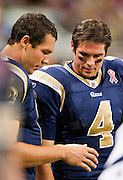 ST. LOUIS, MO - SEPTEMBER 11:   A.J. Feeley #4 looks at the finger injury of Sam Bradford #8 of the St. Louis Rams during a game against the Philadelphia Eagles at the Edward Jones Dome on September 11, 2011 in St. Louis, Missouri.  The Eagles defeated the Rams 31 to 13.  (Photo by Wesley Hitt/Getty Images) *** Local Caption *** A.J. Feeley; Sam Bradford