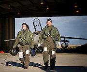 Flt Lt Sarah Carmichael and Flt Lt James Porteous walk from their aircraft after a QRA mission around the Falklands Islands, at RAF Mount Pleasant,  15th September 2009.