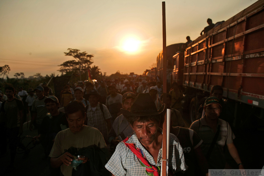 Bolivian indigenous demonstrators march on a road near the village of Santa Fe, some 110 km from Santa Cruz, Bolivia Tuesday, Sept. 16, 2008. Tens of thousands of indigenous demonstrator, supporters of president Evo Morales are marching towards the opposition stronghold of Santa Cruz de la Sierra to demand imprisonment of governor Leopoldo Fernandez and that oppositors return state offices they seized last week during violent protests that ended up with several people dead.(AP Photo/Dado Galdieri)