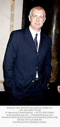 Musician NEIL TENNANT at a party in London on 15th April 2003. PIX 432
