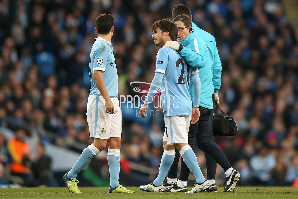 Manchester City midfielder David Silva (21)  leaves the pitch injured during the Champions League match between Manchester City and Real Madrid at the Etihad Stadium, Manchester, England on 26 April 2016. Photo by Simon Davies.