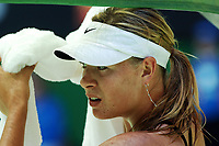 Australian Open Tennis Melbourne 16/01/2007<br /> Maria Sharapova (RUS) tries to stay cool as she  wins  first round match<br /> Photo Roger Parker Fotosports International