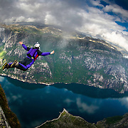 A BASE Jumper exiting from Kjerag.  Lysefjorden, Norway.