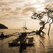 """Bunkai at Sarangani village at the end of the day.<br /> <br /> The SARANGANS showcase enormous cultural diversity of Blaan, Tboli, Tagakaolo, Kalagan, Manobo, Ubo, Muslim tribes and Christian settlers. Hospitable and fun-loving """"Sarangans"""" (people of Sarangani) adhere to a unified direction for development.<br /> Muslim consists of 7 groups; the Lumads, 17; and the migrant settlers, at least 20. The Blaans characterize the largest minority and are distributed in the municipalities of Malapatan, Glan, Alabel, Maasim, and Malungon. A bulk of this tribe is found in Malapatan constituting 37% of the municipal household population.<br /> The Maguindanaos are settled in the municipalities of Malapatan, Maitum, and Maasim; Tbolis reside mostly in Maitum, Kiamba, and Maasim while Tagakaolos subsist entirely in Malungon.<br /> Cebuano settlers are found in Glan and Alabel; Ilonggos are situated in Malungon while the Ilocanos live mostly in Kiamba and Maitum.<br /> Thus, Sarangani's mixed population of Cebuano-speaking Blaans and Muslims in the east coast, Ilocano-speaking Tbolis, Manobos and Muslims in the west coast, and Ilonggo-speaking Blaans and Kaolos in the north uplands, is unique and in harmony."""