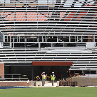 Thomas Wells | Buy at PHOTOS.DJOURNAL.COM<br /> Construction managers go over what's left for the day as work continues on the North endzone expansion at vaught-Hemmingway Stadium Friday in Oxford.