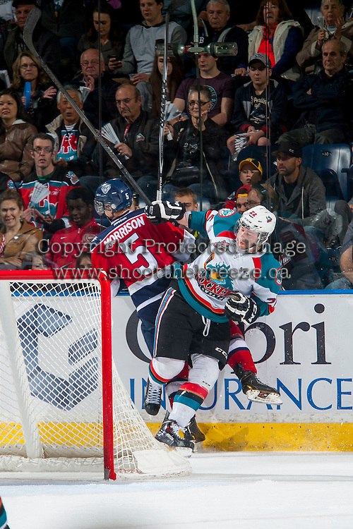 KELOWNA, CANADA - MARCH 27: Chance Braid #22 of Kelowna Rockets checks Tyler Morrison #5 of Tri-City Americans at the boards behind the net on March 27, 2015 at Prospera Place in Kelowna, British Columbia, Canada.  (Photo by Marissa Baecker/Shoot the Breeze)  *** Local Caption *** Chance Braid; Tyler Morrison;
