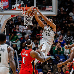 Dec 13, 2017; New Orleans, LA, USA; Milwaukee Bucks forward Giannis Antetokounmpo (34) dunks over New Orleans Pelicans center DeMarcus Cousins (0) during the second half at the Smoothie King Center. The Pelicans defeated the Bucks 115-108. Mandatory Credit: Derick E. Hingle-USA TODAY Sports