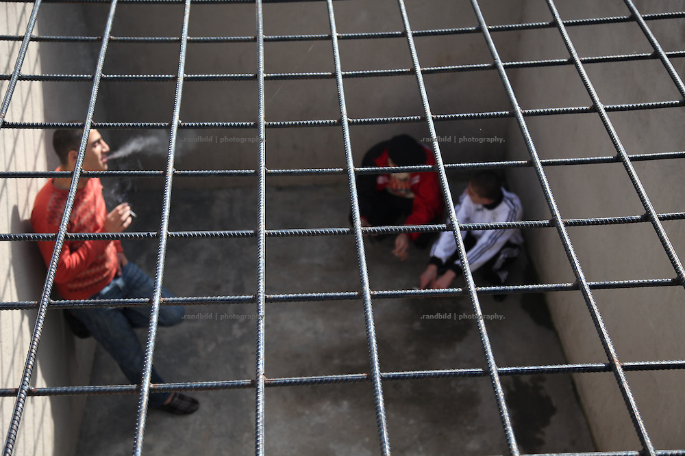 The Women and Youth Prison Abovian near the armenian capital Yerevan. Abovian, where about 200 criminal offenders are imprisoned, represents the most modern jail of Armenia, even many devlopements must be done to become western european standart. Picture: young offenders walking around an outside cage and smoke.