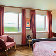 Hotel Látrabjarg, Westfjorden Iceland.<br /> Beuatifull hotel near the cliffs of Westfjorden with large Puffin colony and breathtaking sunset.