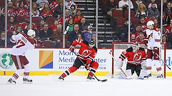 Mar 27, 2014; Newark, NJ, USA; New Jersey Devils defenseman Jon Merrill (34) blocks a shot by Phoenix Coyotes right wing Radim Vrbata (17) during the first period at Prudential Center.