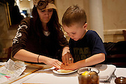 Taryn Nielsen, left, helps her son Spencer press a piece of pizza dough during lunch at BRIO Tuscan Grill in Murray, Friday, Nov. 9, 2012.