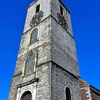 St. Anne&rsquo;s Church Bell Tower in Cork, Ireland<br /> The Italianate-style bell tower of St. Anne&rsquo;s church has been a landmark of Cork&rsquo;s Shandon neighborhood since it was built in 1722.  Perched 164 feet above is a gilded fish weathervane.  Just below are two clocks.  Notice how they are several minutes apart? The other two on this tower probably display different times. This is why the tower is nicknamed, &ldquo;The Four-face Liar.&rdquo;  You can climb the 132 steps for a great view of Cork and ring the the eight Shandon Bells in the belfry.
