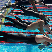 Swimmers, some wearing suits at the start of the Men's 50m Butterfly  heats at the World Swimming Championships in Rome on Sunday, July 26, 2009. Photo Tim Clayton.