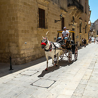 Horse and carriage ride, Mdina;<br />Gozo, Malta, Europe.<br />Summer 2016.