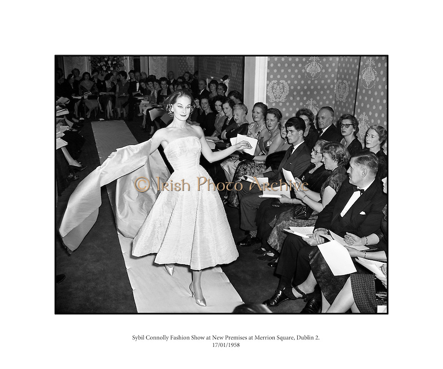 Sybil Connolly Fashion Show at New Premises at Merrion Sq..17/01/1958..Sybil Connolly (24 January 1921, Swansea, Wales - 6 May 1998, Dublin) was an Irish fashion designer for Brunschwig & Fils, F. Schumacher & Co., Tiffany & Co., etc. She was named to the International Best Dressed List Hall of Fame in 1965..Sybil Connolly was born to a Welsh mother and an Irish father; they moved to County Waterford, where she was educated at a convent school run by the Sisters of Mercy. Her interest in fashion led her to London, aged 17, to study dressmaking with Bradley & Co..Her clothes were sought after in the United States and she had an impressive list of clients from prominent families such as the Rockefellers, Mellons and Duponts, to famous actresses of the day. Jacqueline Kennedy wore a Sybil Connolly creation when she sat for her official White House portrait and visited the designer in Ireland. A showcase for her excellent taste in interior decoration, her home was featured in House Beautiful in 1967.[citation needed].In the 1980s, Sybil Connolly began designing for luxury goods makers Tiffany & Co of New York, Tipperary Crystal, Brunschwig & Fils, and Schumacher. Connolly lived at 71 Merrion Square in Dublin for many years and died there in May 1998. Considered one of Dublin's finest Georgian Squares, Merrion Square was first laid out in 1762 and mostly completed by the beginning of the 19th century. Now home to a number of prestigious organizations, including the Irish Red Cross, the National Gallery of Ireland and the National Museum of Ireland, the square was mainly residential up until the 1960s. The square boasted a number of notable residents during its history, including Oscar Wilde at No. 1, the poet William Butler Yeats at No. 82, and at No. 58, Daniel O'Connell, an Irish politician and campaigned for Catholic emancipation..She returned to Ireland at the outbreak of World War II and lived there for the rest of her life, making her home at number 71 Merrion Squa