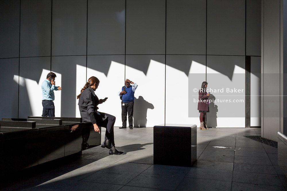 Office workers enjoy the warmth of autumnal sunshine outside the Willis Towers Watson building on Fenchurch Avenue in the heart of the capital's financial district (aka The Square Mile), on 25th September 2018, in London, England.