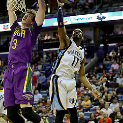 Feb 1, 2016; New Orleans, LA, USA; New Orleans Pelicans center Omer Asik (3) dunks over Memphis Grizzlies guard Mike Conley (11) during the second half of a game at the Smoothie King Center. The Grizzlies defeated the Pelicans 110-95. Mandatory Credit: Derick E. Hingle-USA TODAY Sports