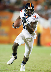 Virginia wide receiver Maurice Covington (80) rushes up field after a pass reception.  The #19 Virginia Cavaliers defeated the Miami Hurricanes 48-0 at the Orange Bowl in Miami, Florida on November 10, 2007.  The game was the final game played in the Orange Bowl.