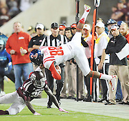 Mississippi Rebels wide receiver Cody Core (88) is upended by Texas A&M Aggies defensive back Deshazor Everett (29) on a 21 yard pass play in College Station, Texas on Saturday, October 11, 2014.