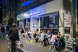 Night view of Fleischerei cafe restaurant in bohemian Prenzlauer Berg in Berlin Germany