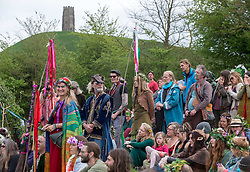 © Licensed to London News Pictures. 01/05/2018. Glastonbury, Somerset, UK. Beltane springtime celebrations on the first day in May in Glastonbury, with a ritual procession through the town and a hand fasting pagan wedding ceremony and a maypole dance. Photo credit: Simon Chapman/LNP