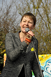 © Licensed to London News Pictures. 10/03/2012. Green MP Caroline Lucas speaking at an anti-nuclear demonstration at Hinkley Point nuclear power station in Somerset, UK, on the anniversary of the Fukushima nuclear disaster in Japan.  EDF Energy plans to build a new nuclear power station at Hinkley C powered by EPR reactors..Photo credit : Simon Chapman/LNP