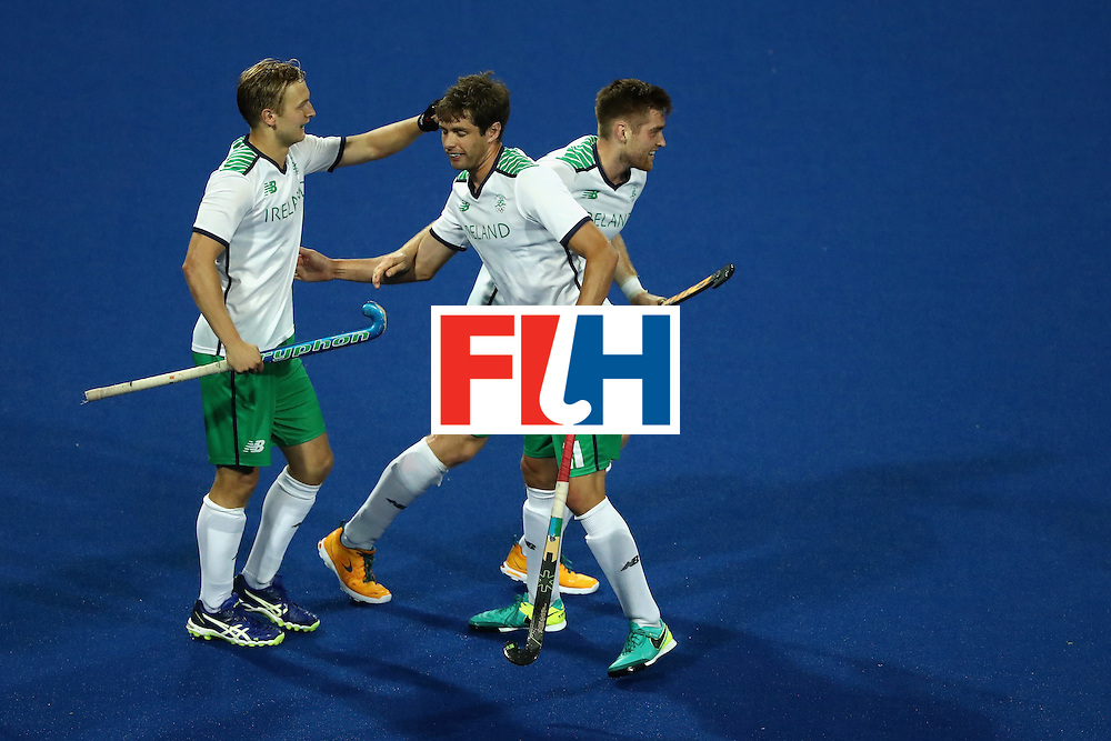 RIO DE JANEIRO, BRAZIL - AUGUST 12:  John Jermyn #11, Shane O'Donoghue #16, and Michael Watt #7 of Ireland react to scoring a goal against Argentina during a Men's Preliminary Pool A match on Day 7 of the Rio 2016 Olympic Games at the Olympic Hockey Centre on August 12, 2016 in Rio de Janeiro, Brazil.  (Photo by Sean M. Haffey/Getty Images)