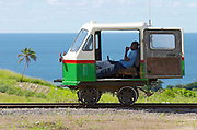 An advance draisine controlling the tracks waits for the departure of the St. Kitts Scenic Railway. This former sugar cane railway has been converted into a tourist train with luxurious 2-storey carriages (AC below, open air above). It runs along the island's coastline in a big circle, offering spectacular views on villages, sugar estates, beaches and cliffs.
