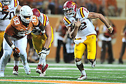 AUSTIN, TX - OCTOBER 18:  Sam B. Richardson #12 of the Iowa State Cyclones scrambles against the Texas Longhorns on October 18, 2014 at Darrell K Royal-Texas Memorial Stadium in Austin, Texas.  (Photo by Cooper Neill/Getty Images) *** Local Caption *** Sam B. Richardson