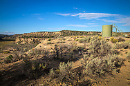 A well site on Don Schreiber's  ranch in Blanco, New Mexico. He is standing infront of one of the wells recently redrilled on BLM land that he leases.