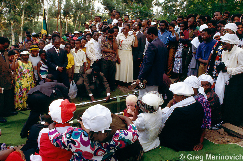 KwaZulu Natal, South Africa 1992-4. A funeral for an ANC supporting  victim of political violence, KwaZuluNatal. Albino child on mother's lap.
