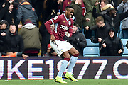 Aston Villa striker Jonathan Kodjia (26)  scores a goal and celebrates  1-1 during the EFL Sky Bet Championship match between Aston Villa and Birmingham City at Villa Park, Birmingham, England on 25 November 2018.