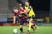 Burton Albion midfielder Ryan Edwards fouls Bournemouth midfielder Ryan Fraser during the EFL Cup match between Burton Albion and Bournemouth at the Pirelli Stadium, Burton upon Trent, England on 25 September 2019.