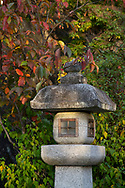 Autumn foliage around a stone lantern on Philosopher's Walk (Tetsugakku) in Kyoto, Japan