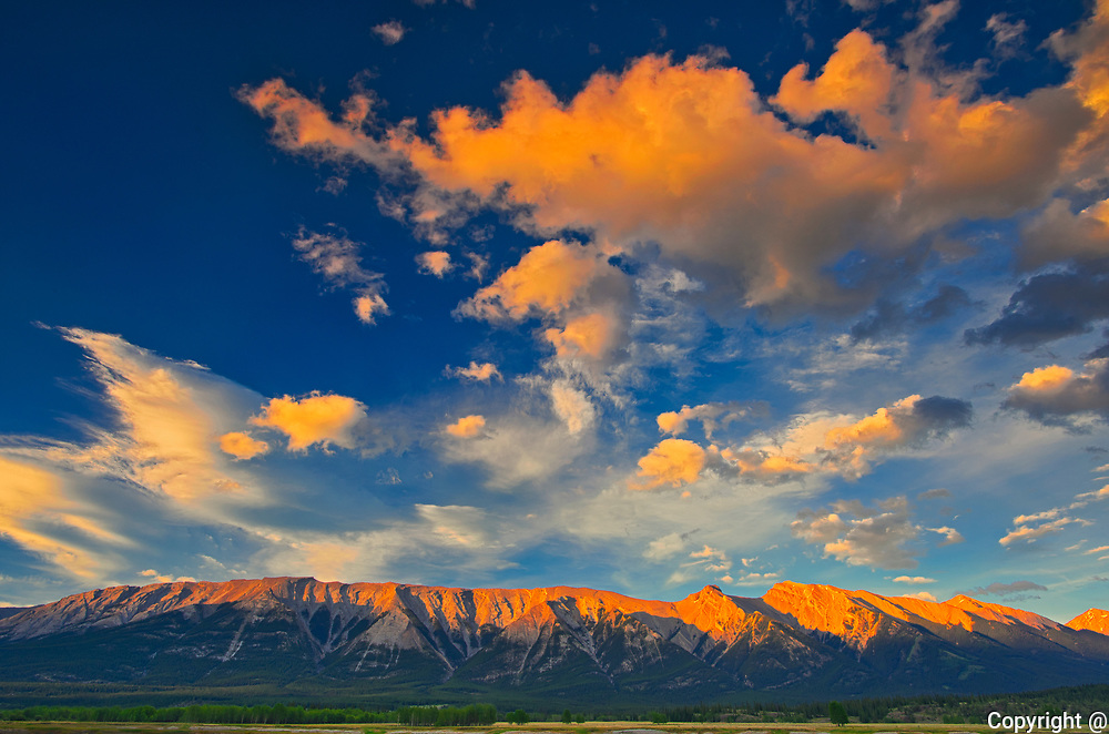 Clouds and The Canadian Rocky Mountains at sunrise. <br />
