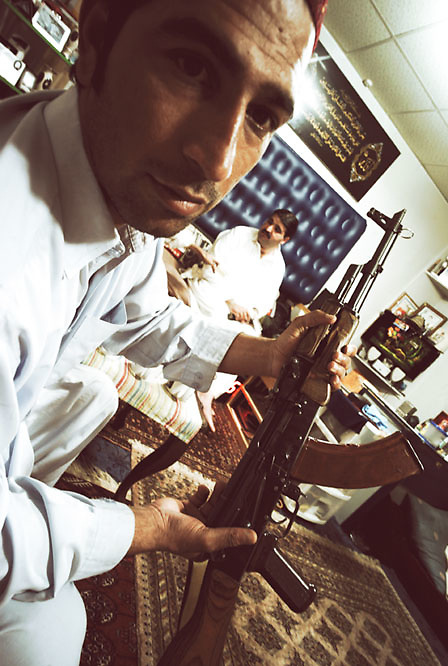 A man exhibits a gun at the home of a local drug lord who is responsible for the trafficking of vast quantities of heroine and cocaine within the tribal regions at the Smuggler's Bazaar, Khyber-Pakhtunkhwa, Pakistan on 25th Sep, 2007..