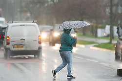 ©Licensed to London News Pictures 09/01/2020<br /> Orpington ,UK Wet weather for this parent in Orpington, Kent as she walks to school to collect her children. Heavy rain this afternoon as The Met Office has warned that downpours and strong winds will make driving conditions difficult. Photo credit: Grant Falvey/LNP