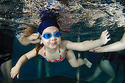 Mother supports her daughter underwater