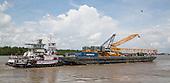 Barge docks to unload crane for Sarens