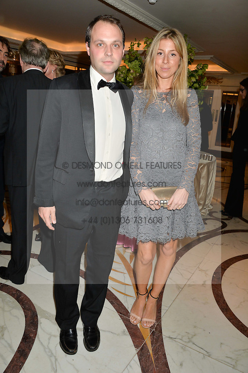 Left to right, the HON.EDWARD SACKVILLE and his wife SOPHIA at the 24th Cartier Racing Awards held at The Dorchester, Park Lane, London on 11th November 2014.