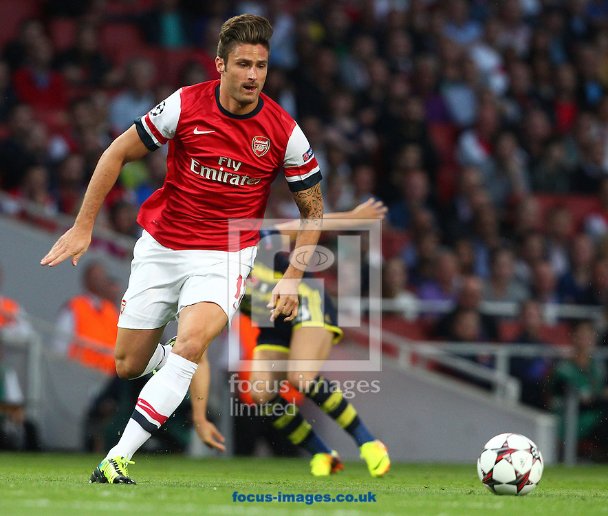 Picture by Paul Terry/Focus Images Ltd +44 7545 642257<br /> 27/08/2013<br /> Olivier Giroud of Arsenal during the UEFA Champions League match at the Emirates Stadium, London.