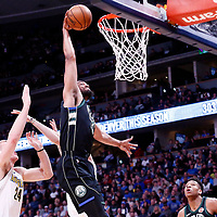 01 April 2018: Milwaukee Bucks forward Jabari Parker (12) goes for the dunk during the Denver Nuggets 128-125 victory over the Milwaukee Bucks, at the Pepsi Center, Denver, Colorado, USA.