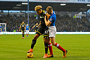 Lyle Taylor (33) of AFC Wimbledon battles for possession with Matt Clarke (5) of Portsmouth during the EFL Sky Bet League 1 match between Portsmouth and AFC Wimbledon at Fratton Park, Portsmouth, England on 26 December 2017. Photo by Graham Hunt.