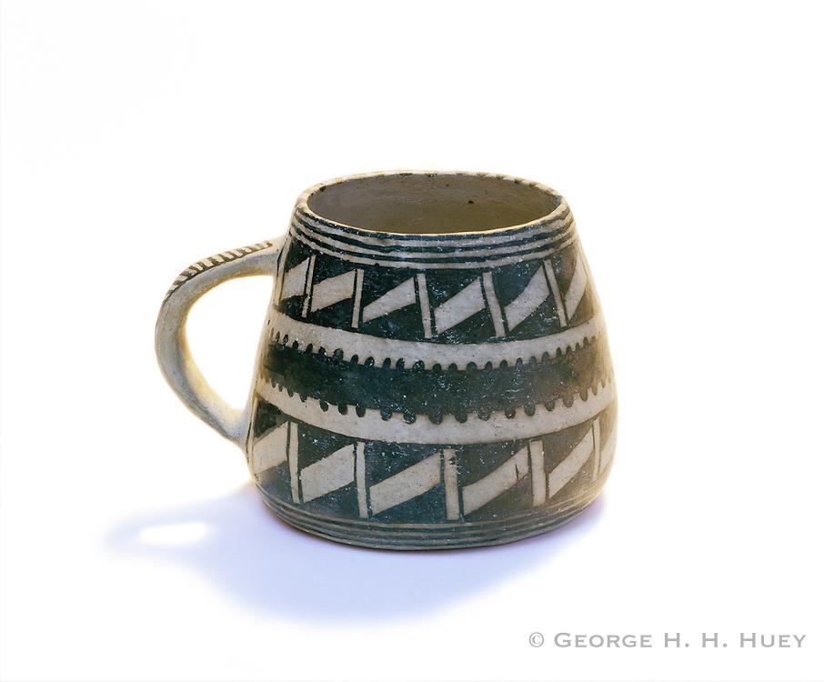 0405-1126NF ~ Copyright: George H.H. Huey ~ Mesa Verde Black-on-White style mug with handle.  Anazai culture [aka Puebloan culture].  Circa 1100-1300 A.D.  Mesa Verde National Park, Colorado.