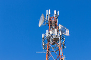 cellular and microwave antennas on a red and white communications tower in Goondiwindi, Queensland, Australia <br /> <br /> Editions:- Open Edition Print / Stock Image