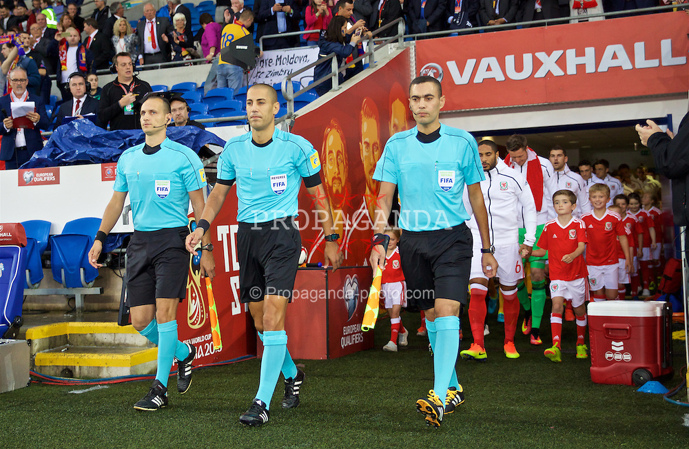 CARDIFF, WALES - Monday, September 5, 2016: Referee Liran Liany, of Israel, and his assistants David Elias Biton and Mahmud Mahagna lead the Wales and Moldova teams out before the 2018 FIFA World Cup Qualifying Group D match at the Cardiff City Stadium. (Pic by David Rawcliffe/Propaganda)
