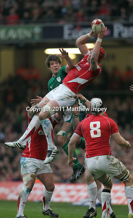 Alun Wyn Jones of Wales and Donnacha O'Callaghan of Ireland compete for the ball at the re-start. Wales v Ireland, RBS 6 Nations, Millennium Stadium, Cardiff, Rugby Union, 12/03/2011 © Matthew Impey/Wiredphotos.co.uk. tel: 07789 130 347 email: matt@wiredphotos.co.uk