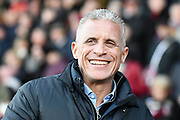 Northampton Town manager Keith Curle smiles during the EFL Sky Bet League 2 match between Northampton Town and Forest Green Rovers at the PTS Academy Stadium, Northampton, England on 14 December 2019.